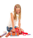 Girl makes a gift Royalty Free Stock Photography