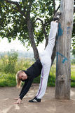 Girl makes gym split in the city park Stock Images