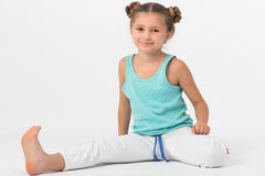 Girl makes gymnastic exercise Stock Image
