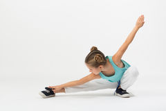 A girl makes gymnastic exercise Stock Photography