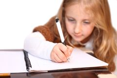 Girl makes lessons Stock Photo