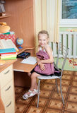 Girl makes lessons Royalty Free Stock Photo