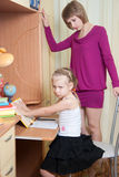 Girl makes lessons Royalty Free Stock Image
