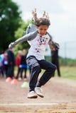 Girl makes long jump Royalty Free Stock Image
