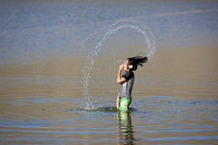 Girl makes pattern with water. Royalty Free Stock Image