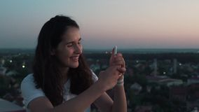Girl makes a photo from the roof.  stock footage