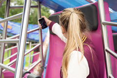 Girl Makes Selfie on the Carousel Royalty Free Stock Photos
