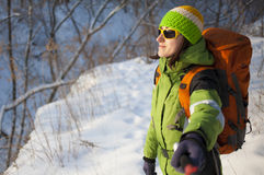 Girl makes a selfie in the forest in winter. Girl makes a selfie during sports in the winter royalty free stock images