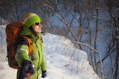 Girl makes a selfie in the forest in winter. Girl makes a selfie during sports in the winter stock image
