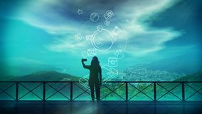 The girl makes selfie and infographics about social networks. Silhouette of a girl doing selfie on a background of beautiful scenery and on the background of Stock Photography