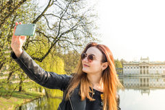 The girl makes selfie Stock Images