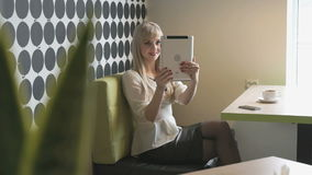 Girl makes selfie using a computer tablet stock footage