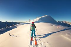 Girl makes ski mountaineering alone toward the mountain pass in a nice track with sealskin stock photography