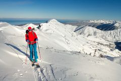 Girl makes ski mountaineering alone toward the mountain pass in a nice track with sealskin stock image