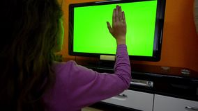 Girl makes touchless contorl on smart TV stock video footage