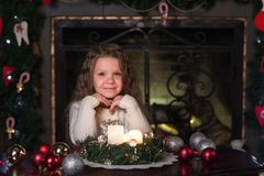 Girl makes a wish at Christmas Stock Images