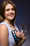 Girl with  makeup. Beautiful girl with  brush and paint Royalty Free Stock Photo