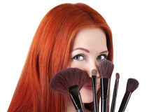 Girl makeup artist with brushes closeup Royalty Free Stock Photos