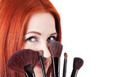 Girl makeup artist with brushes closeup Royalty Free Stock Image