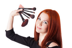 Girl makeup artist with brushes closeup Stock Image