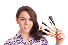 Girl makeup artist with brushes Stock Photography