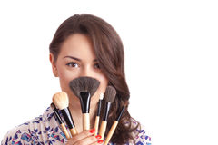 Girl makeup artist with brushes Stock Photo