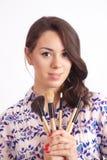 Girl makeup artist with brushes Stock Photos