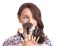 Girl makeup artist with brushes Stock Images