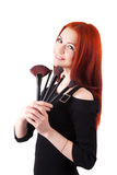 Girl makeup artist with brushes Stock Image