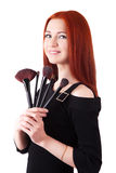 Girl makeup artist with brushes Royalty Free Stock Photo