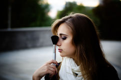 Girl with makeup brush Royalty Free Stock Image