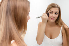 Girl with Makeup Brush Royalty Free Stock Images