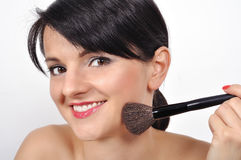 Girl with makeup brush Royalty Free Stock Photos