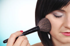 Girl with makeup brush. Young girl with makeup brush, close up Royalty Free Stock Images