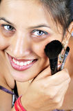 Girl with makeup brushes Stock Photography