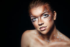 Girl with makeup deer Stock Images