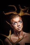 Girl with makeup deer Stock Image