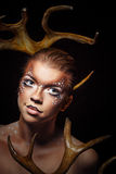 Girl with makeup deer Royalty Free Stock Image