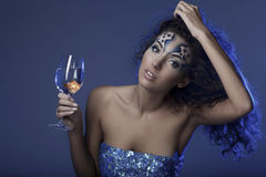 Girl with makeup, with a fish in a glass Stock Photos