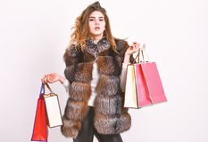 Girl makeup furry coat shopping white background. Shopping or birthday gifts. Woman shopping luxury boutique. Lady hold stock photography