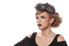 Girl with makeup and gothic masquerade mask. Royalty Free Stock Image
