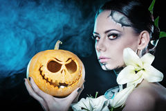 Girl with makeup for Halloween. Pumpkin Royalty Free Stock Images