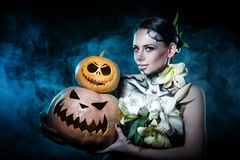 Girl with makeup for Halloween. Pumpkins Royalty Free Stock Photo
