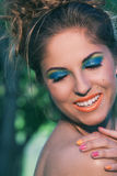 Girl with makeup and handmade bracelets Royalty Free Stock Photo