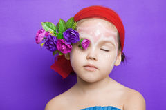 Girl with makeup on her face Stock Photos