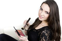 Girl with makeup  holding brush and blush palette Royalty Free Stock Photography