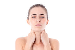 Girl without makeup looks straight and keeps hands behind the neck is isolated on a white background Royalty Free Stock Photography