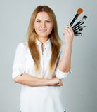 Girl makeup with Professional brushes Stock Photo
