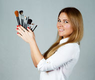 Girl makeup with Professional brushes Stock Photography