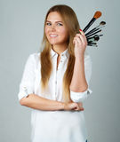 Girl makeup with Professional brushes Royalty Free Stock Photography